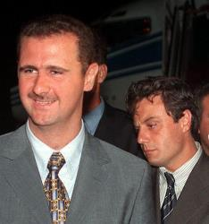 Manaf Tlass, to the right of Assad, is a member of one of Syria's most powerful families.