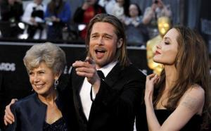 From left, Jane Pitt, Brad Pitt and Angelina Jolie arrive before the 84th Academy Awards on Sunday, Feb. 26, 2012, in the Hollywood section of Los Angeles.
