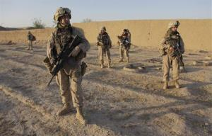Members of a 'female engagement team' take position before making contact with locals in an Afghan village.
