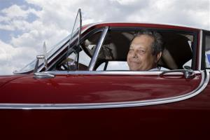 Irv Gordon poses for a picture in his Volvo P1800 in Babylon, NY, Monday, July 2, 2012.