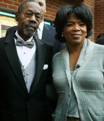 Vernon Winfrey and daughter Oprah Winfrey arrive at the opening of Charlie's War at the Nashville Film Festival at the Green Hills Regal Cinema May 2, 2003, in Nashville, Tennessee.