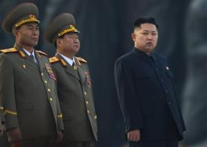 In this April 13, 2012 photo, North Korean leader Kim Jong Un stands next to senior military leaders.