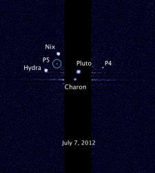 This image, taken by the NASA/ESA Hubble Space Telescope, shows five moons orbiting the distant, icy dwarf planet Pluto. The green circle marks the newly discovered moon, designated S/2012 (134340) 1, or P5.