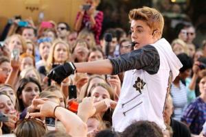 This image released by Starpix shows singer Justin Bieber performing on the Today show as part of their summer concert series in Rockefeller Center, Friday, June 15, 2012 in New York.