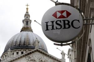A sign for HSBC bank is seen at a branch in the City of London