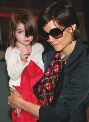 Katie Holmes and daughter Suri arrive at Narita International Airport in Narita, east of Tokyo, in 2009.
