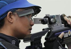 Malaysia's Nur Suryani Taibi competes in the women's 10-meter air rifle shooting final at the 16th Asian Games in Guangzhou, China in 2010.