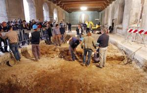 Researchers dig into underground tombs inside the Convent of St. Ursula, in Florence, Italy, Wednesday, May 11, 2011, during a media tour.