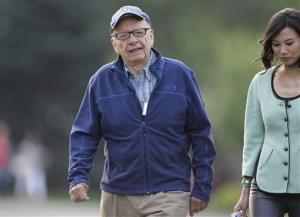 Media mogul Rupert Murdoch and his wife, Wendi Deng, arrive at the Allen & Company Sun Valley Conference in Sun Valley, Idaho, Thursday, July 12, 2012.