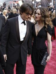 Johnny Depp and Vanessa Paradis arrive for the 80th Academy Awards Sunday, Feb. 24, 2008, in Los Angeles.
