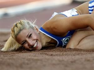 Greece's Voula Papachristou lands in the sand after her jump at the Women's Triple Jump final at the European Athletics Championships in Helsinki, Finland, in this file photo dated Friday, June 29.