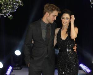 Robert Pattinson and Kristen Stewart arrive for the UK film premiere of 'Twilight Breaking Dawn Part 1' at Westfield Stratford in east London, Wednesday, Nov. 16, 2011.