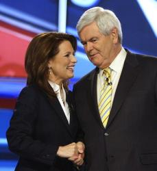 Michele Bachmann and Newt Gingrich talk during a break in the first New Hampshire Republican presidential debate at St. Anselm College in Manchester, NH, Monday, June 13, 2011.