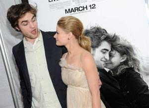 Robert Pattinson and Emilie de Ravin attend the premiere of 'Remember Me' at the Paris Theater on March 1, 2010 in New York. Did Pattinson's friendship with de Ravin spur Kristen Stewart to cheat?
