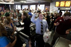 A Chick-fil-A worker cheers at a Mississippi restaurant.
