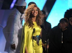 Beyonce accepts the award for best female R&B at the BET Awards on Sunday, July 1, 2012, in Los Angeles.