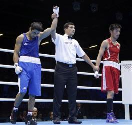 Azerbaijan's Magomed Abdulhamidov is declared the winner over Japan's Satoshi Shimizu.