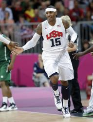 USA's Carmelo Anthony celebrates a score against Nigeria during a preliminary men's basketball game at the 2012 Summer Olympics, Thursday, Aug. 2, 2012, in London.