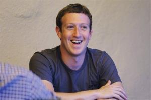 Facebook CEO Mark Zuckerberg smiles at the Allen & Company Sun Valley Conference in Sun Valley, Idaho, Thursday, July 12, 2012.