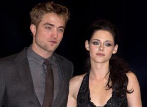In this Nov. 16, 2011 file photo, British actor Robert Pattinson, left, and US actress Kristen Stewart arrive at the UK film premiere of Twilight Breaking Dawn Part 1.