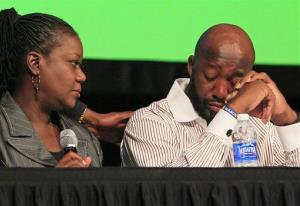 Sybrina Fulton, left, consoles Tracy Martin after Martin spoke about their son, Trayvon Martin, at the Children's Defense Fund national conference, Wednesday, July 25, 2012, in Cincinnati.