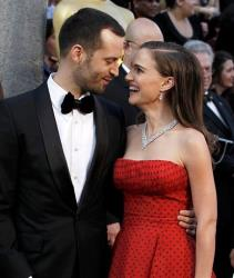Benjamin Millepied, left, and Natalie Portman arrive before the 84th Academy Awards on Sunday, Feb. 26, 2012, in the Hollywood section of Los Angeles.