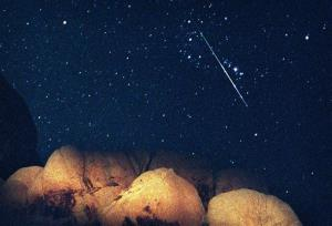 In this Aug. 12, 1997 file picture, a bright Perseid Meteor cuts across Orion's Belt during the peak of the annual Perseid Meteor Shower seen from Joshua Tree National Park, Calif.