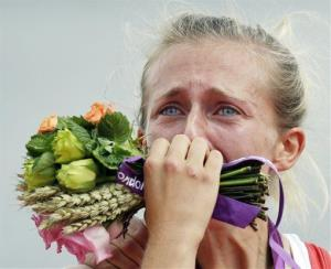 Great Britain's Katherine Copeland cries during the award ceremony for the lightweight women's rowing double sculls after winning the gold medal at the 2012 Summer Olympics, Saturday, Aug. 4, 2012.