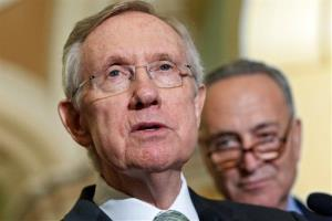 Harry Reid speaks to reporters at the Capitol in Washington, Wednesday, July 25, 2012. At right is Sen. Charles Schumer.