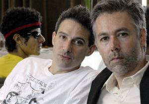 In this 2006 file photo, Beastie Boys members Adam Yauch MCA, right, Adam Horovitz Adrock, center, and Mike Diamond Mike D, reflected in a mirror, pose during an interview in Toronto.