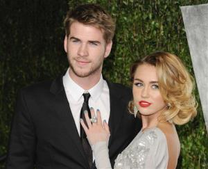 This Feb. 26, 2012 file photo shows Miley Cyrus, right, and Liam Hemsworth at the Vanity Fair Oscar party in West Hollywood, Calif.