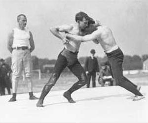 Two unidentified wrestlers compete in the 1904 summer Olympics.