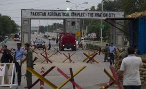 Pakistani security personnel guard the main entrance of Minhas air base, 50 miles northwest of Islamabad.