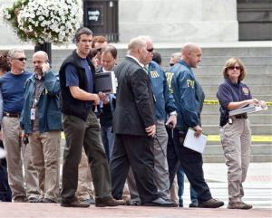 Washington Police and FBI agents gather outside the Family Research Council in Washington, Wednesday, Aug. 15, 2012.