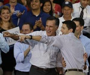 Mitt Romney and Paul Ryan point to people in the crowd at a rally Aug. 12 in Waukesha, Wis.