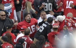 In this photo from Aug. 20, 2011, fans fight in the stands during a preseason game between the San Francisco 49ers and the Oakland Raiders in San Francisco.