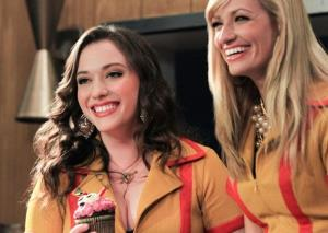 Kat Dennings, left, and Beth Behrs are shown in a scene from the comedy series 2 Broke Girls.