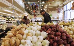 Customers select produce at a supermarket in Chicago in this file photo.