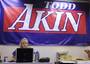 A banner hangs in the campaign office of GOP Rep. Todd Akin n Chesterfield, Mo. The deadline for him to easily drop out of the race passed yesterday.