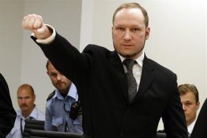 Anders Behring Breivik, makes a salute after arriving at an Oslo court room today.  Breivik was convicted today of terrorism and premeditated murder for bomb and gun attacks that killed 77 people.