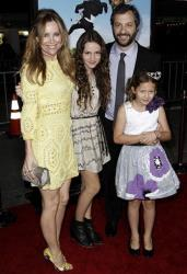 From left, Leslie Mann, Maude Apatow, Judd Apatow, and Iris Apatow arrive at the premiere of Wanderlust in Los Angeles, Thursday, Feb. 16, 2012.