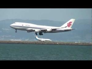 An Air China 747 like the one forced to return to Beijing lands in San Francisco.