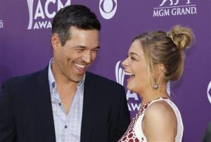 LeAnn Rimes, right, and Eddie Cibrian arrive at the 47th Annual Academy of Country Music Awards on Sunday, April 1, 2012 in Las Vegas.