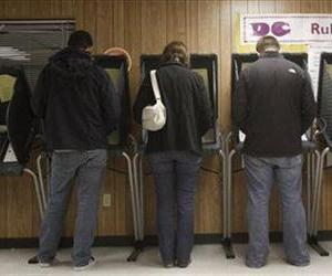 Voters cast their ballots at a polling station in East  Austin, Texas, Tuesday, Nov. 2, 2010.