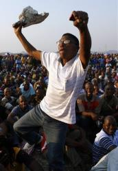 A mine worker sings and dances during a gathering at the Lonmin Platinum Mine near Rustenburg, South Africa, Wednesday.