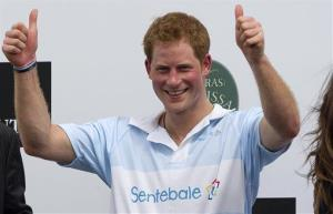 Prince Harry gives a thumbs up during the award ceremony after playing a charity polo match in Campinas, Brazil, Sunday, March 11, 2012.