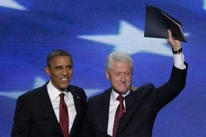Clinton waves to the delegates as he stands with President  Obama after addressing the Democratic National Convention.
