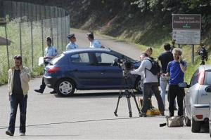 Journalists wait in front of Gendarmes, who block access to the site of a killing near Chevaline, French Alps, Thursday Sept. 6, 2012.