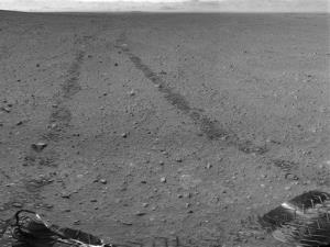 Curiosity's tracks as seen from its rear-facing camera.