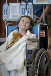 Seven-year-old Sierra Jane Downing from Pagosa Springs, Colo., smiles in a Denver hospital.